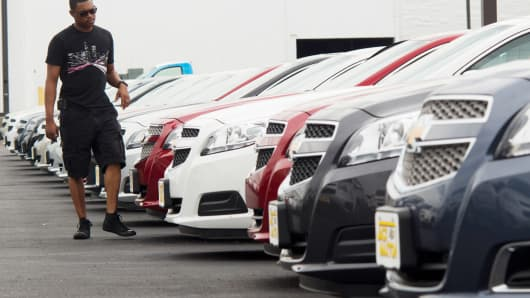 A customer browses through rows of cars for sale at the Jack Maxton Chevrolet dealership in Columbus, Ohio, U.S.