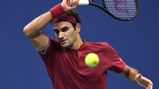 Roger Federer of Switzerland hits to John Millman of Australia in a round of 16 match on day eight of the 2018 U.S. Open tennis tournament at USTA Billie Jean King National Tennis Center.