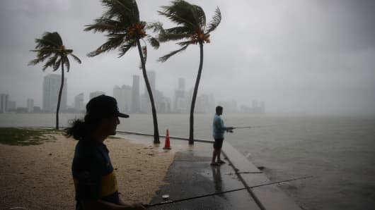 People fish as rain and wind are whipped up by Tropical Storm Gordon on September 3, 2018 in Miami, Florida.