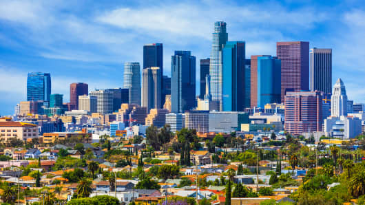 Urban sprawl fills the foreground leading back to the skyscrapers of Los Angeles.