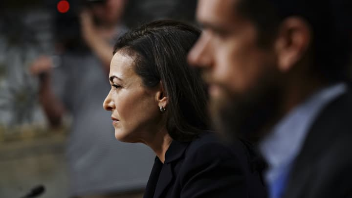 Sheryl Sandberg, chief operating officer of Facebook Inc., left, listens during a Senate Intelligence Committee hearing in Washington, D.C., U.S., on Wednesday, Sept. 5, 2018.