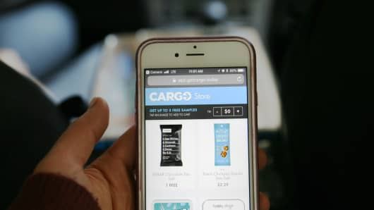 Cargo is a box that sits on the center console of cars that offers snacks, drinks, chargers and more to riders for purchase.