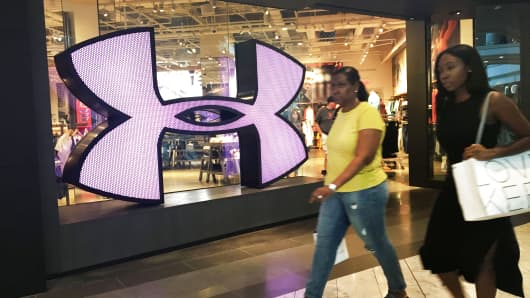 Shoppers pass an Under Armour store in White Plains, New York.