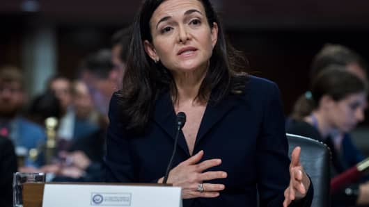 Sheryl Sandberg, Facebook COO, and Jack Dorsey, Twitter CEO,  off camera, testify during a Senate (Select) Intelligence Committee hearing in Dirksen Building where they testified on the influence of foreign operations on social media on September 5, 2018.