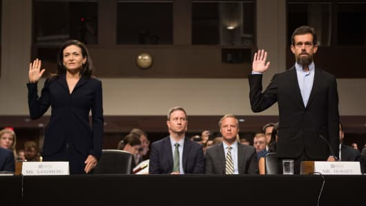 CEO of Twitter Jack Dorsey (R) and Facebook COO Sheryl Sandberg (L) are sworn in to testify before the Senate Intelligence Committee on September 5, 2018.