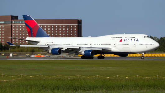 A Delta Air Lines Boeing 747-400 ready to depart from Tokyo Narita airport.