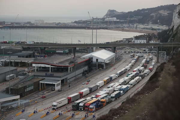 Lorries queue up at the port of Dover. Dover handles up to £122 billion ($172 billion, 140 billion euros) of trade annually, with trucks currently processed in two minutes.