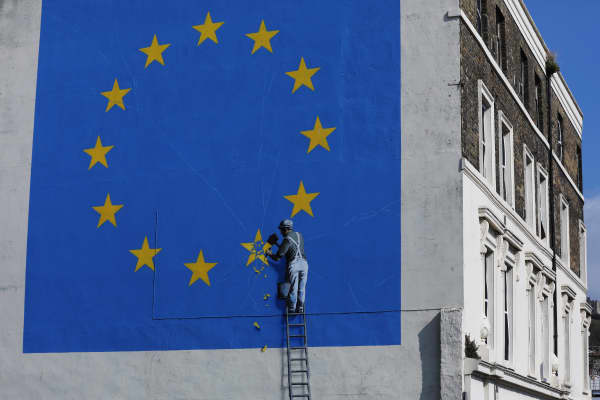 A mural by street artist Banksy depicting a European Union (EU) flag being chiseled by a workman covers the side of a building in Dover, U.K., on Friday, Sep. 22, 2017.