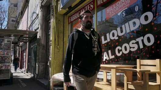 A man walks past a store selling off in Buenos Aires, on September 4, 2018.