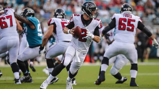 Atlanta Falcons quarterback Matt Ryan rolls out during the game between the Atlanta Falcons and the Jacksonville Jaguars.