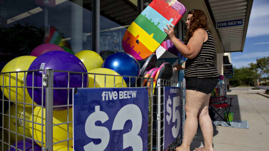 A shopper browses a selection of body boards outside a Five Below store in Bloomington, Illinois, on Wednesday, July 25, 2018.