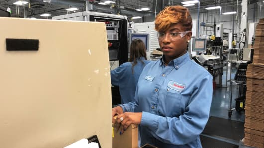 Taylor Williams has worked her way up at Rockwell's Twinsburg facility and says the company invested in her by paying her college tuition at Tiffin University.