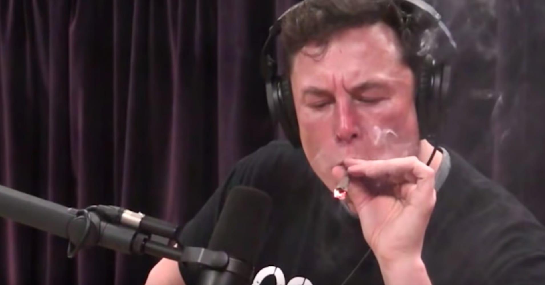 Elon Musk smokes marijuana with Joe Rogan's during a taping of Rogan's podcast show.