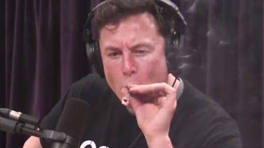 Elon Musk smokes marijuana with Joe Rogan during a taping of Rogan's podcast show.