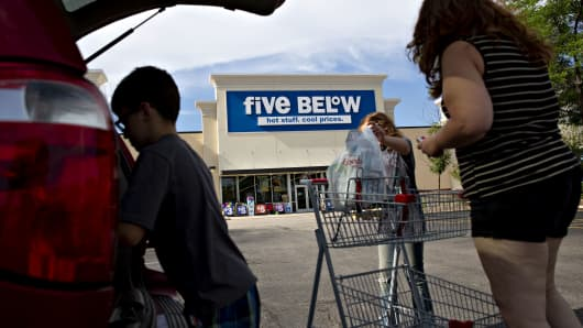 Shoppers place purchases into vehicle outside a Five Below store in Bloomington, Illinois, on Wednesday, July 25, 2018.