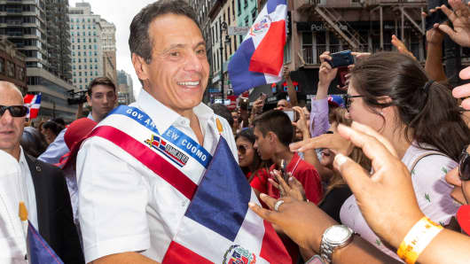 New York State Governor Andrew Cuomo greets spectators during Dominican Day parade 2018 on 6th Avenue.