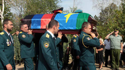A burial ceremony for Alexander Zakharchenko, head of the Donetsk People's Republic, takes place at the Donetskoye More cemetery in Donetsk. Zakharchenko was killed in a blast at the Separ cafe on August 31, 2018.