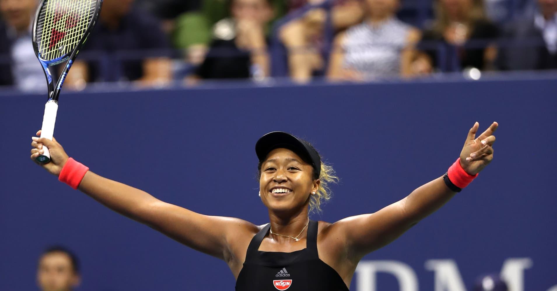 Naomi Osaka of Japan celebrates her semi-final win over Madison Keys at the 2018 US Open