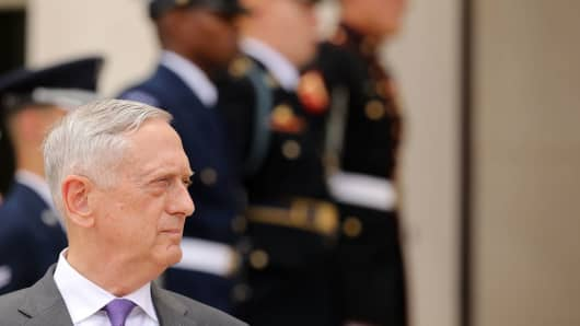 Defense Secretary James Mattis waits for the arrival of German Defence Minister Ursula von der Leyen outside the Pentagon June 20, 2018.