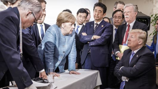 German Chancellor Angela Merkel deliberates with U.S. President Donald Trump during the G-7 summit in Canada on June 9, 2018.