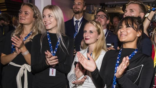 Members and supporters of the far-right Sweden Democrats react to the results of the exit polls at their party election center on September 9, 2018 in Stockholm, Sweden.