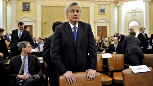 Jamie Dimon, chairman, president, and chief executive officer of JPMorgan Chase & Co., center, waits for the start of a hearing before the Financial Crisis Inquiry Commission in Washington, D.C., U.S., on Wednesday, Jan. 13, 2010.