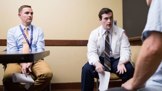 Matthew DeFazio, center, a medical student at Boston University, asks a fictional patient, portrayed by Ric Mauré, right, about his drug use. Dr. Bradley M. Buchheit coaches.