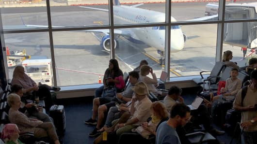 Passengers waiting to board a Delta airlines plane at La Guardia  International Airport in New York.