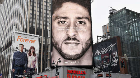A Nike Ad featuring American football quarterback  Colin Kaepernick is on diplay September 8, 2018 in New York City. - Nike's new ad campaign featuring Kaepernick, the American football player turned activist against police violence, takes a strong stance on a divisive issue which could score points with millennials but risks alienating conservative customers.