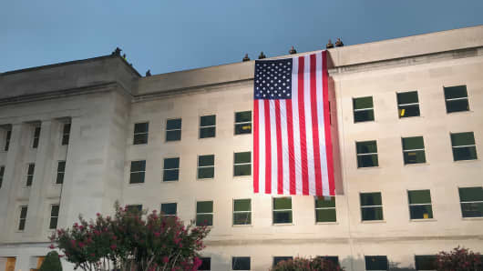 The American flag hangs over the west side of the Pentagon to mark the 17th anniversary of the September 11, 2001 attacks.