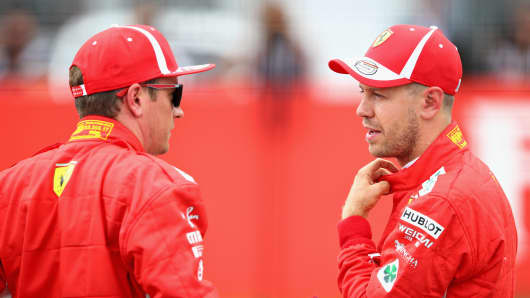 Sebastian Vettel of Germany and Ferrari talks with Kimi Raikkonen of Finland and Ferrari in parc ferme during qualifying for the Formula One Grand Prix of Germany at Hockenheimring on July 21, 2018 in Hockenheim, Germany.