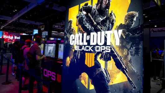 Attendees play the Activision Blizzard Inc. Call Of Duty: Black Ops 4 video game at the company's booth during the E3 Electronic Entertainment Expo in Los Angeles, California, U.S., on Tuesday, June 12, 2018.