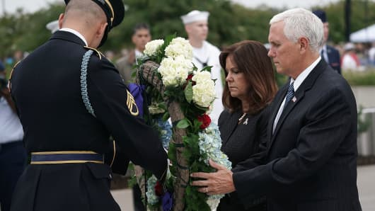 U.S. Vice President Mike Pence and second lady Karen Pence lay a wreath during a cereomy at the National 9/11 Pentagon Memorial to mark the 17th anniversary of the 9/11 terror attacks September 11, 2018 in Arlington, Virginia. The nation observed 9/11 terror attacks that killed nearly 3000 people on American soil in 2001.