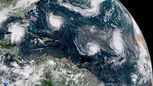 In this satellite image provided by NOAA, Hurricane Florence churns through the Atlantic Ocean toward the U.S. East Coast, followed to the east first by Hurricane Isaac and then Hurricane Helene on September 11, 2018.