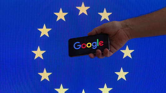 The European Union flag is seen with Google's logo.