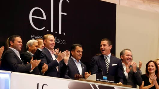 Tarang Amin (C), Chairman and CEO of cosmetics company e.l.f. Beauty Inc., rings the opening bell at the New York Stock Exchange (NYSE) to celebrate his company's IPO in New York City, U.S. September 22, 2016.