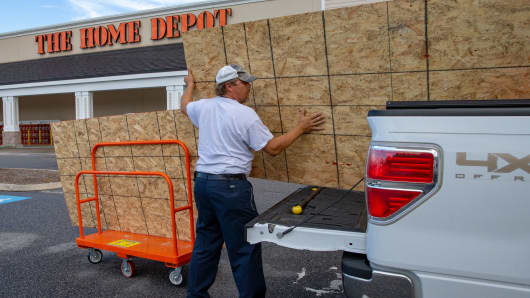 Craig Hubbs loads wood into his truck at a The Home Depot store in Kill Devil Hills in the Outer Banks of North Carolina on September 11, 2018.