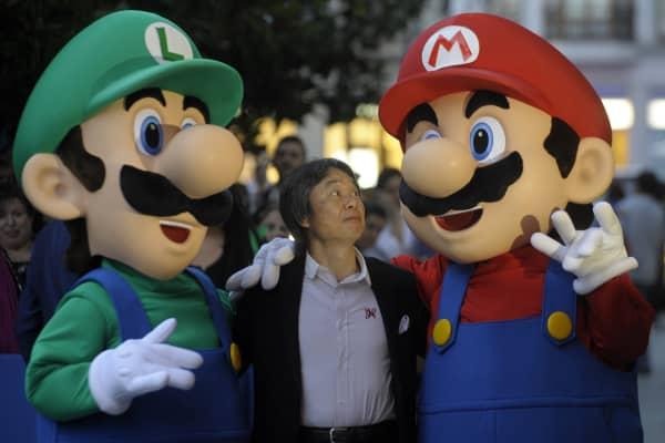 Nintendo designer Shigeru Miyamoto with characters Luigi (left) and Mario (right).