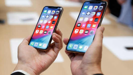 A man holds the Apple iPhone XS and XS Max during a product demonstration following the Apple launch event at the Steve Jobs Theater in Cupertino, California, September 12, 2018.