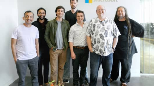 The Lobe team, along with Microsoft's Umesh Madan, left; Gaz Iqbal, second from left; Kevin Scott, second from right; and Jaron Lanier, right.