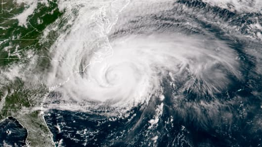 In this NOAA satellite handout image, shows Hurricane Florence it just makes landfall off the coast of the U.S. in the Atlantic Ocean on September 13, 2018. Coastal cities in North Carolina, South Carolina and Virginia are under evacuation orders as the Category 2 hurricane approaches the United States.