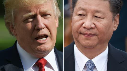 Combination of file photos showing U.S. President Donald Trump and Chinese President Xi Jinping.