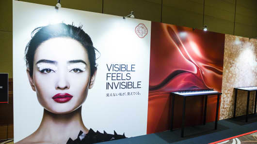 An advertising hoarding for the Shiseido Co. new makeup line, left, is displayed at the company's news conference in Tokyo, Japan, on Wednesday, Aug. 1, 2018.