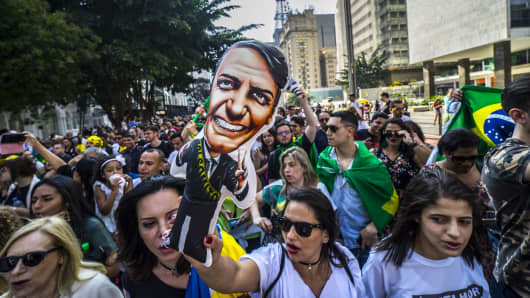 Supporters of Brazilian right-wing presidential candidate Jair Bolsonaro take part in a rally in Sao Paulo, Brazil on September 09, 2018.