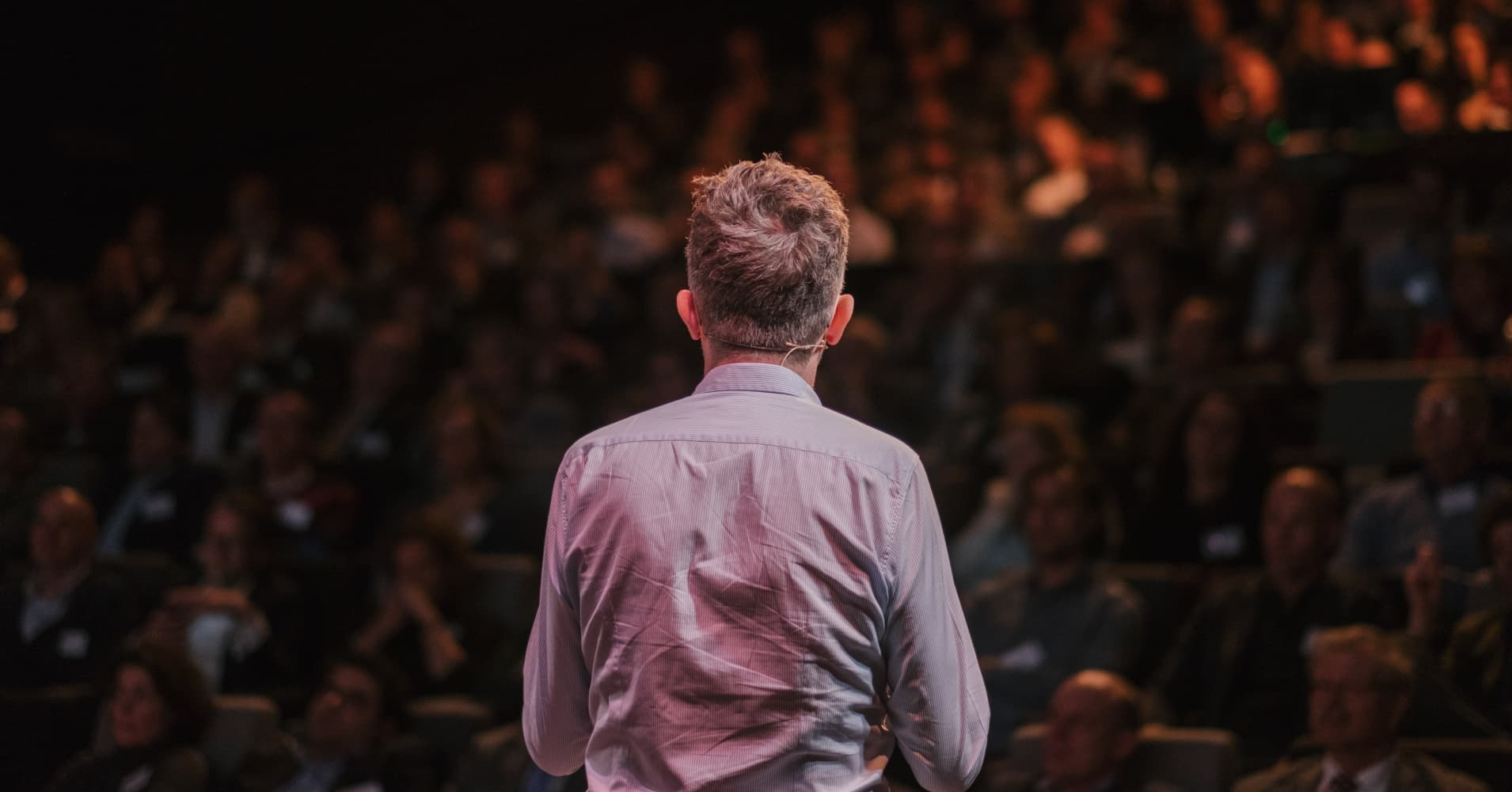 Rear View Of A Male Speaker