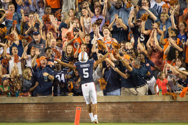 Wide receiver Anthony Schwartz #5 of the Auburn Tigers celebrates with fans after scoring a touchdown in the first half during their game against the Alabama State Hornets at Jordan-Hare Stadium on September 8, 2018 in Auburn, Alabama