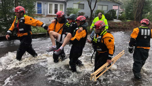 Search and Rescue workers from New York rescue a man from flooding caused by Hurricane Florence in River Bend, North Carolina.
