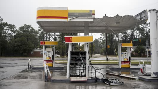 Debris lies on the ground at a Royal Dutch Shell Plc gas station damaged during Hurricane Florence in Wilmington, North Carolina, U.S., on Friday, Sept. 14, 2018.