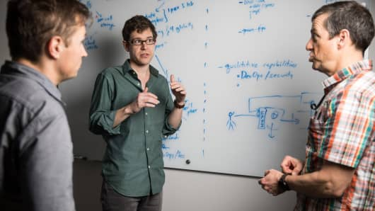 Jeremy Freeman, CZI's director of computational biology (center) in conversation with principal engineer Andrey Kislyuk (left) and director of engineering Bruce Martin (right)