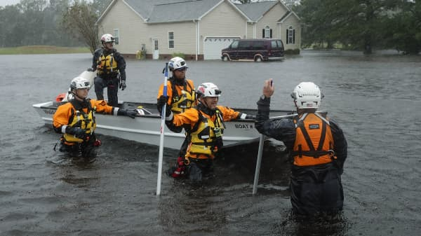 Members of the FEMA Urban Search and Rescue Task Force 4 from Oakland, California, search a flooded neighborhood for evacuees during Hurricane Florence September 14, 2018 in Fairfield Harbour, North Carolina.